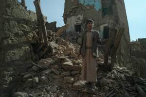 Abdul Bassat, 12, stands at the place where the house of his aunt used to be. His neighbourhood of mud-briks ancient buildings in Rahban, the area on the outskirts of Sa'dah city was destroyed by several Saudi-led airstrikes in May, 2015. Sa'dah province is the stronghold of the Houthi insurgency movement in Yemen, which emerged here in 2004. In 2004-2010 it experienced six wars launched by the Ali Abdullah Saleh government against the Houthi rebels. Rahban area, as well as old Sa'dah city, are included on Yemen's World Heritage Tentative List.